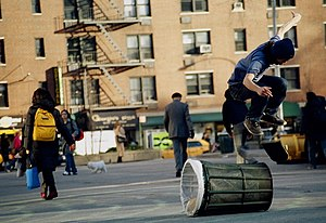Street skateboarding - Jumping a bin in New York City.