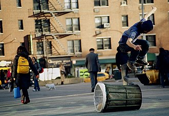 Street skateboarding - A flip over a bin at a spot in NYC.