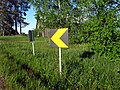 Finnish left curve sign.jpg