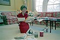First Lady Nancy Reagan reading mail for Pennies for Pandas at the White House.jpg
