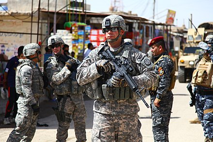 Alabama Army National Guard MP, MSG Schur, during a joint community policing patrol in Basra, 3 April 2010 Flickr - DVIDSHUB - Iraqi Police Build Relationships in Basra.jpg