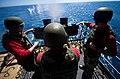 Flickr - Official U.S. Navy Imagery - A Sailor fires a machine gun. (3).jpg
