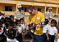 Flickr - Official U.S. Navy Imagery - A Sailor sings to Cambodian children..jpg