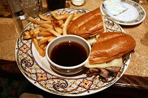 Au jus - French dip beef sandwich, with bowl of jus for dipping