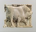 Furniture or cosmetic box plaque carved in relief with a striding bull MET DP110702.jpg