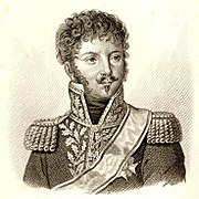 Black and white print of a man with a moustache and small goatee in a dark military uniform with epaulettes and a high collar