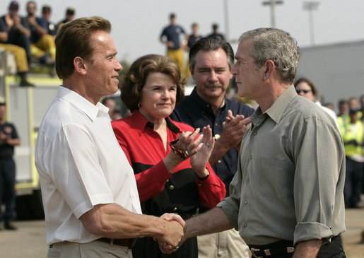 GW. Bush shakes hands with A. Schwarzenegger, Oct. 25, 2007