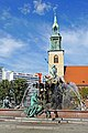 Germany-00056 - Neptune Fountain with St May's Church (29695725283).jpg