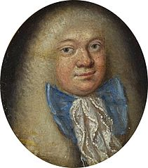 Miniature of a man in a bright wig and a blue bow.