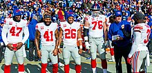 Barkley alongside other Giants' team captains in a game against the Washington Redskins