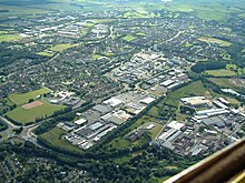 Aerial image of central and southern Glenrothes (looking southwest) showing the town centre shopping mall, Queensway retail park and the industrial and housing estates surrounding the centre
