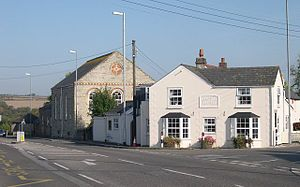 """Goonhavern - The Methodist church and a house called """"Central Cottage"""" on the main road to Newquay"""