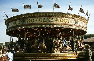 Fair - Roundabouts (also known as carousels and merry-go-rounds) are traditional attractions, often seen at fairs