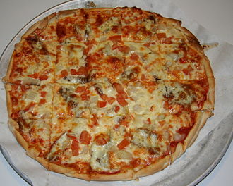 Greek pizza - A Greek-style pizza with feta cheese, onion, olive and tomato