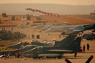 HAL Tejas - Tejas parked next to F-16 Fighting Falcon (centre) and Eurofighter Typhoon (top) at 2009 Aero India