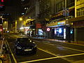 HK Sheung Wan night Queen's Road Central sidewalk carpark black.JPG