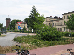 Hagenow Land station - Ensemble of buildings with the water tower, post office and the entrance building (west side)
