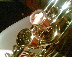 Hagmann valve - Dual independent Hagmann valves on bass trombone, one with end cap removed.
