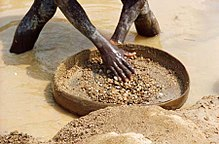 A man panning for diamonds