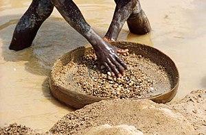 A miner in Kono District, Sierra Leone searche...