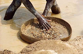 Blood diamond - Panning for diamonds in Sierra Leone.