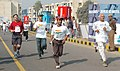 Highlighting the spirit of marathon an elderly person participating in the New Delhi marathon along with younger ones, in New Delhi on February 12, 2006.jpg