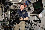 ISS-47 Oleg Skripochka with a camera in the Zvezda Service Module.jpg