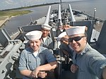 Information Systems Technician 1st Class Justin Sullivan takes a photo with members of the Naval Sea Cadets.jpg