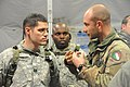 Italian army Capt. Alberto Valent, right, speaks with U.S. Army Capt. Austin Maples, left, with Headquarters and Headquarters Troop, 2nd Cavalry Regiment (CAV), during a decisive action training environment 121027-A-GM460-006.jpg