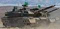 Japanese soldiers prepare a Type 10 main battle tank for a maneuver training exercise during Rising Thunder 2014 at the Yakima Training Center, Wash., Sept 140903-A-BX700-002.jpg
