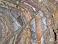 Jaspilite banded iron formation (Soudan Iron-Formation, Neoarchean, ~2.69 Ga; Stuntz Bay Road outcrop, Soudan Underground State Park, Soudan, Minnesota, USA) 50 (19225512495).jpg