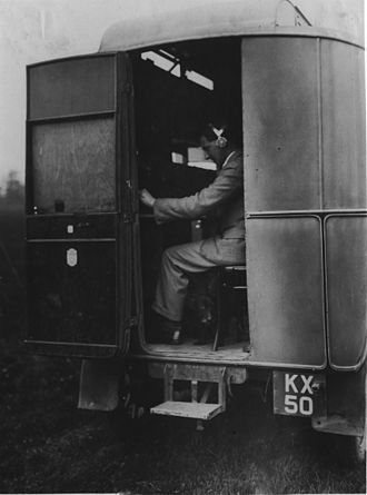 """Chain Home - This Morris Commercial T-type van, originally used as a portable radio reception testbed, was later refitted for the Daventry Experiment. It is shown in 1933, being operated by """"Jock"""" Herd."""