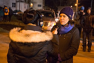 Lisa Bender - Bender being interviewed by a reporter outside the Minneapolis Police Department's Fourth Precinct during the fifth night of demonstrations following the shooting death of Jamar Clark.