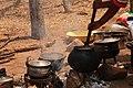 Kalanga woman steering chimonye meal (Kalanga) at Domboshaba cultural festival 2.jpg