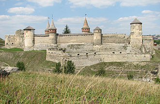 Kamianets-Podilskyi Castle - View of the castle from southwest with the Old Castle (bottom right) and New Castle (top left)