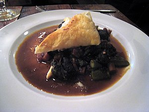 Kedjenou - A Kedjenou variant, prepared with escargot, okra and puff pastry
