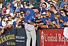 Kris Bryant signing autographs during his rehab assignment against Omaha (44267090382).jpg