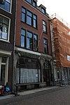 foto van Winkelwoonhuis gebouwd in overgangsarchitectuur
