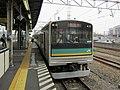 Kumoha 204-1001 at Shitte Station.jpg