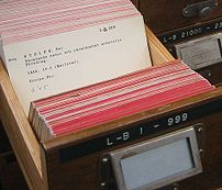 An index card in a card catalog