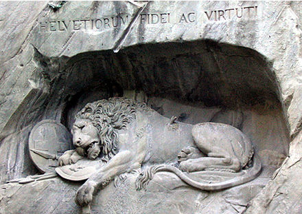 "The Lion Monument in Lucerne. The incised Latin may be translated, ""To the loyalty and courage of the Swiss"". Lionmonumentlucerne.jpg"