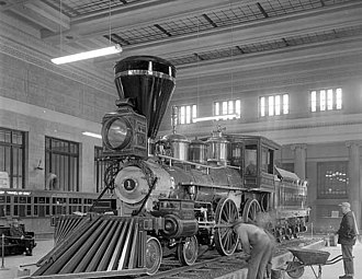 Saint Paul Union Depot - William Crooks locomotive being set up as a static display in the station's waiting room in 1954. The engine remained on display here until 1975, when it was moved to the Lake Superior Railroad Museum in Duluth.