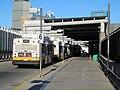 MBTA buses at Ruggles station upper busway, December 2016.JPG