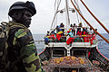 Maitre Cheikh Sidate Camara, a Senegalese navy boarding officer, directs members of a joint boarding team of U.S. Coast Guardsmen and Senegalese sailors during a routine inspection of a fishing vessel June 23 120623-N-GN377-003.jpg