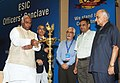 Mallikarjun Kharge lighting the lamp to inaugurate the ESIC Officers Conclave-2011, in New Delhi on July 16, 2011. The Secretary, Labour and Employment, Shri Prabhat C. Chaturvedi is also seen.jpg