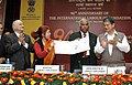 """Mallikarjun Kharge releasing the Commemorative Special Cover, at the celebrations of """"90th Anniversary of International Labour Organisation (ILO)"""", in New Delhi on February 04, 2010.jpg"""