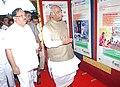Mallikarjun Kharge visiting the DAVP photo exhibition, at the Public Information Campaign on Bharat Nirman, at Gulbarga, Karnataka. The Karnataka State Minorities Welfare Minister, Shri Qamar Ul Islam is also seen.jpg
