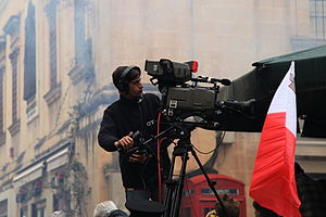 One (Maltese TV channel) - A One TV cameraman during the celebrations after the 2013 elections in Republic Street, Valletta.