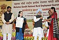 Manmohan Singh presenting award for for Initiative in MGNREGA Administration for the year 2009-10 at the Mahatma Gandhi NREGA Sammelan-2011, on the completion of five years of Mahatma Gandhi NREGA.jpg
