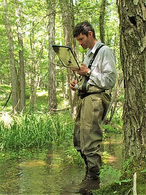 Mark C. Urban - Mark C. Urban conducting field work